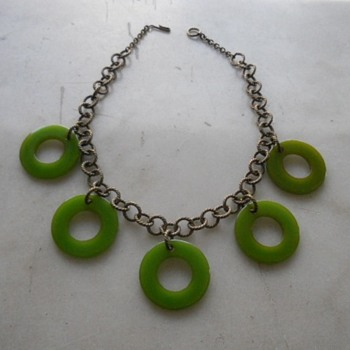 Green bakelite rings given new life as a necklace - Costume Jewelry
