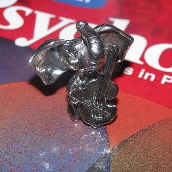 Pewter elephant playing cello