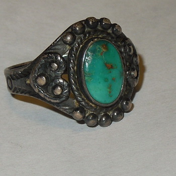 Does anyone know how old this ring might be or anything about it?