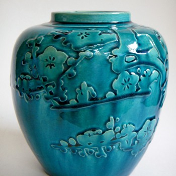 Vintage Japanese pottery vase with relief design