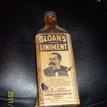 Sloan's Liniment 1/2 full with the liniment - Bottles