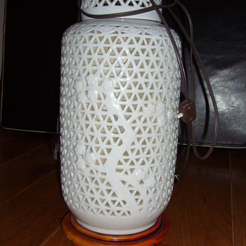 old possibly chinese pierced porcelain and wood table lamp, would love more info and value