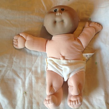 Cabbage patch baby with black head and white body...has anyone else encountered this? - Dolls