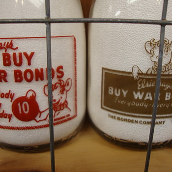 Two Borden Squat Quart War Slogan Milk Bottles......