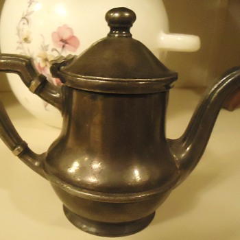 The Wallingford Silver Plate 8 oz. Teapot and Wm. A. Rogers plate  - Kitchen