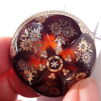 Elaborated domed tortoise brooch and photo locket