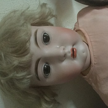 "Bisque head doll no. 15 on neck. Pierced ears 25"" tall"
