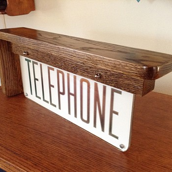 TELEPHONE SCONCE sign