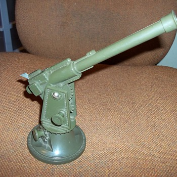 TOY ARTILLERY PIECE