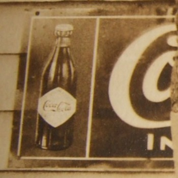 WW1 soldier RPPC in front of Coca Cola sign - Photographs