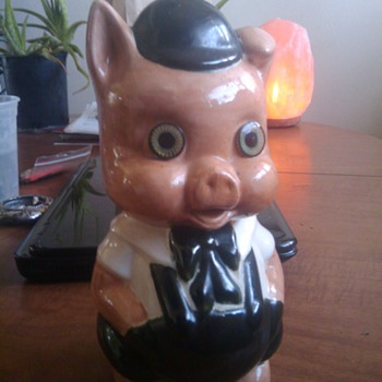 A very cool, old piggy bank with beautiful glass eyes