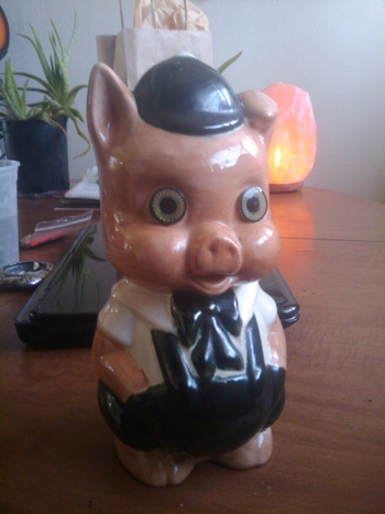 A very cool old piggy bank with beautiful glass eyes for Really cool piggy banks