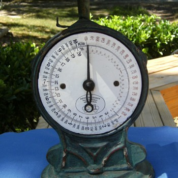 Cast Iron spring type scale with porcelain face