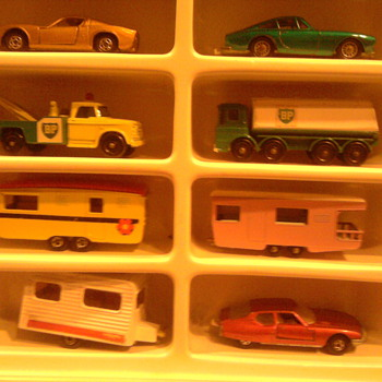 Cars in the display case with plastic curtail removed...To a kid in the 60's, captivating...Kids today...not even a glance!
