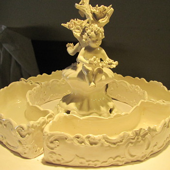 PORCELAIN FIGURINE  - Art Pottery