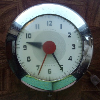 Electric Art Deco chrome wall clock.