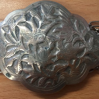 Silver chain-link belt and buckle