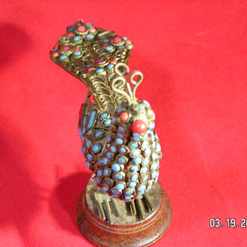 I am told it is late 19th century Victorian Peacock - Victorian Era