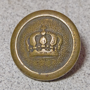 Brass button with crown reverse has I.C.M.