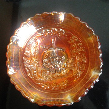 small carnival glass bowl, with windmill pattern.