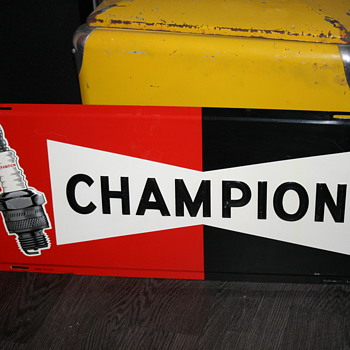 champion tin sign
