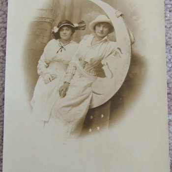 "RPPC of women with ""Man in the Moon"" prop"