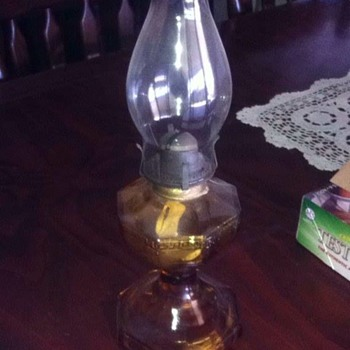 Antique amber glass oil lamp