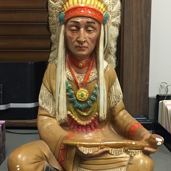 Indian Chief sitting with peace pipe appears to be chalk ware possibly vintage