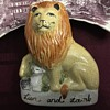 Staffordshire Lion And Lamb figure and clarice Cliff piece