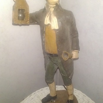 Colonial man holding lamp