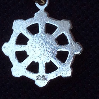 Gold ships wheel pendant