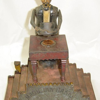 vintage cast iron magician bank.