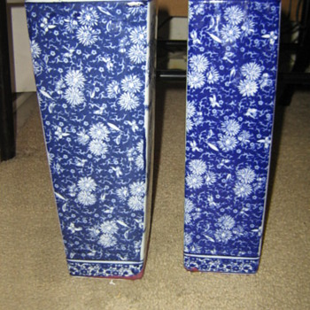 Two blue-flowered vases