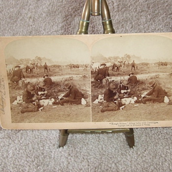 Stereoview of Rough Riders filling cartridge belts  - Military and Wartime