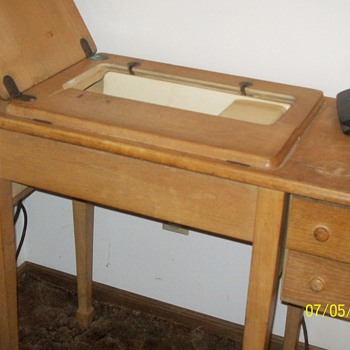 Older Singer in cabinet sewing machines