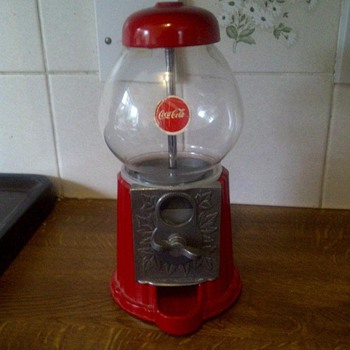 coca cola gumball machine i need to know about this any info will be helpful  - Coin Operated