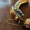 Chinese gold jade enamel bracelet.  Dragons have ruby eyes. Given to me by my husband who has now passed away.