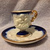Beautiful flow blue demitasse set