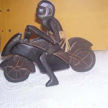 NATIVE NUDE W/ REAL WOVEN HEMP SKIRT ON CARVED WOOD MOTORCYCLE W/UGLY EXPRESSION