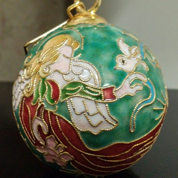 Cloisonne Glass Christmas ornament. Look closely at the hands and arms. :)