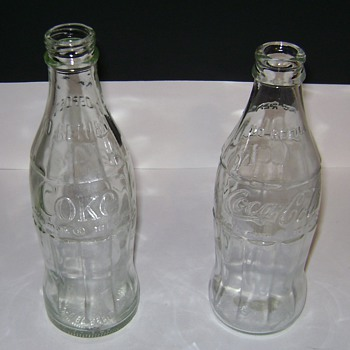 Clear Coca~Cola Bottles