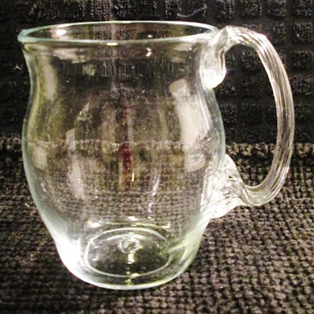 Glass mug with beautiful handle
