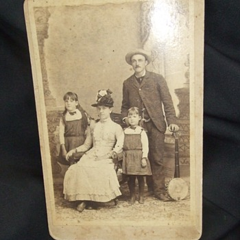 Cabinet card of Man with Family and his Banjo - Photographs
