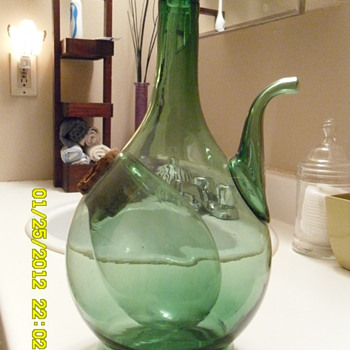 some kind of wine bottle?...with a place for ice? let me know please... - Bottles