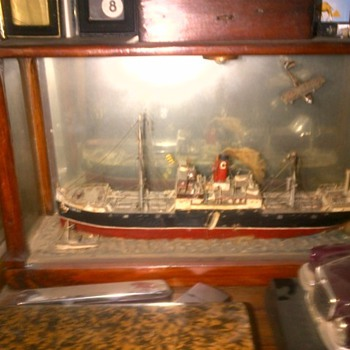 old ship in wood frame and glass around - Toys