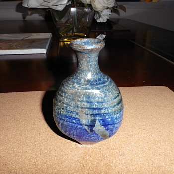 Seeking information about this interesting piece of pottery...