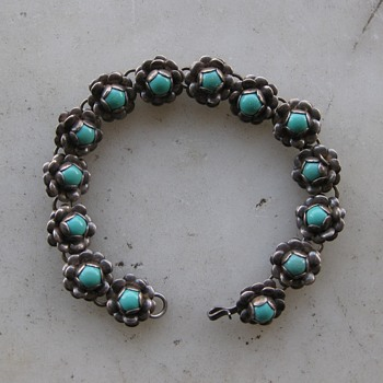 Glass or plastic turquoise in sterling bracelet from Mexico