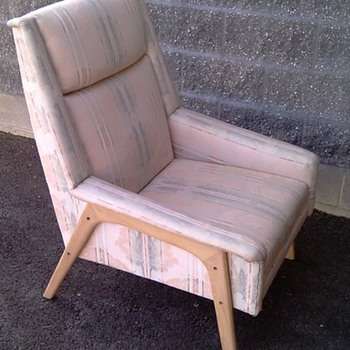 Badly upholstered Dux chair.