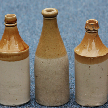 ---Old Tan and White stone wear beer bottles--- - Bottles