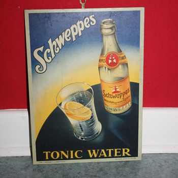 schweppes tonic water tin sign
